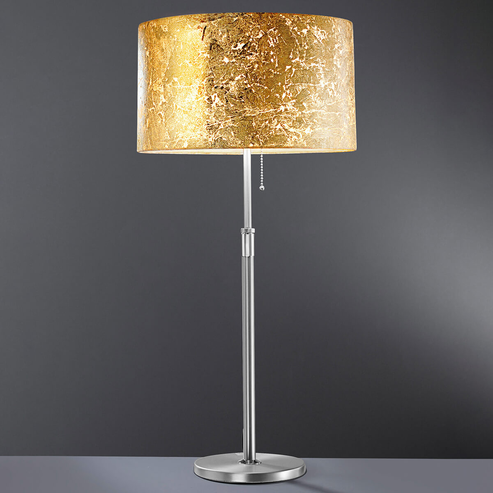 Loop - lampa stołowa z płatkowym złotem