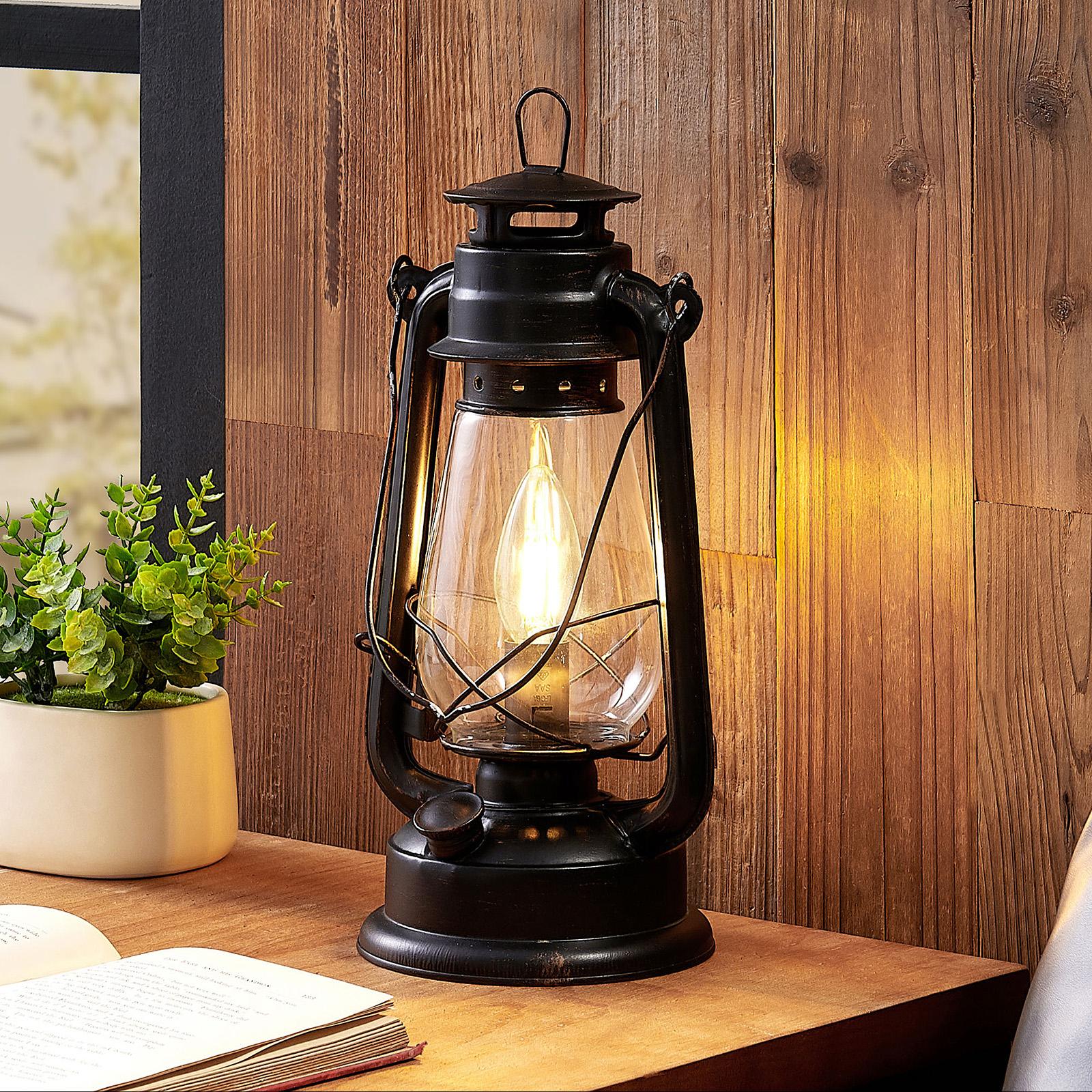 Lindby Raisa lámpara de mesa, farol, color óxido