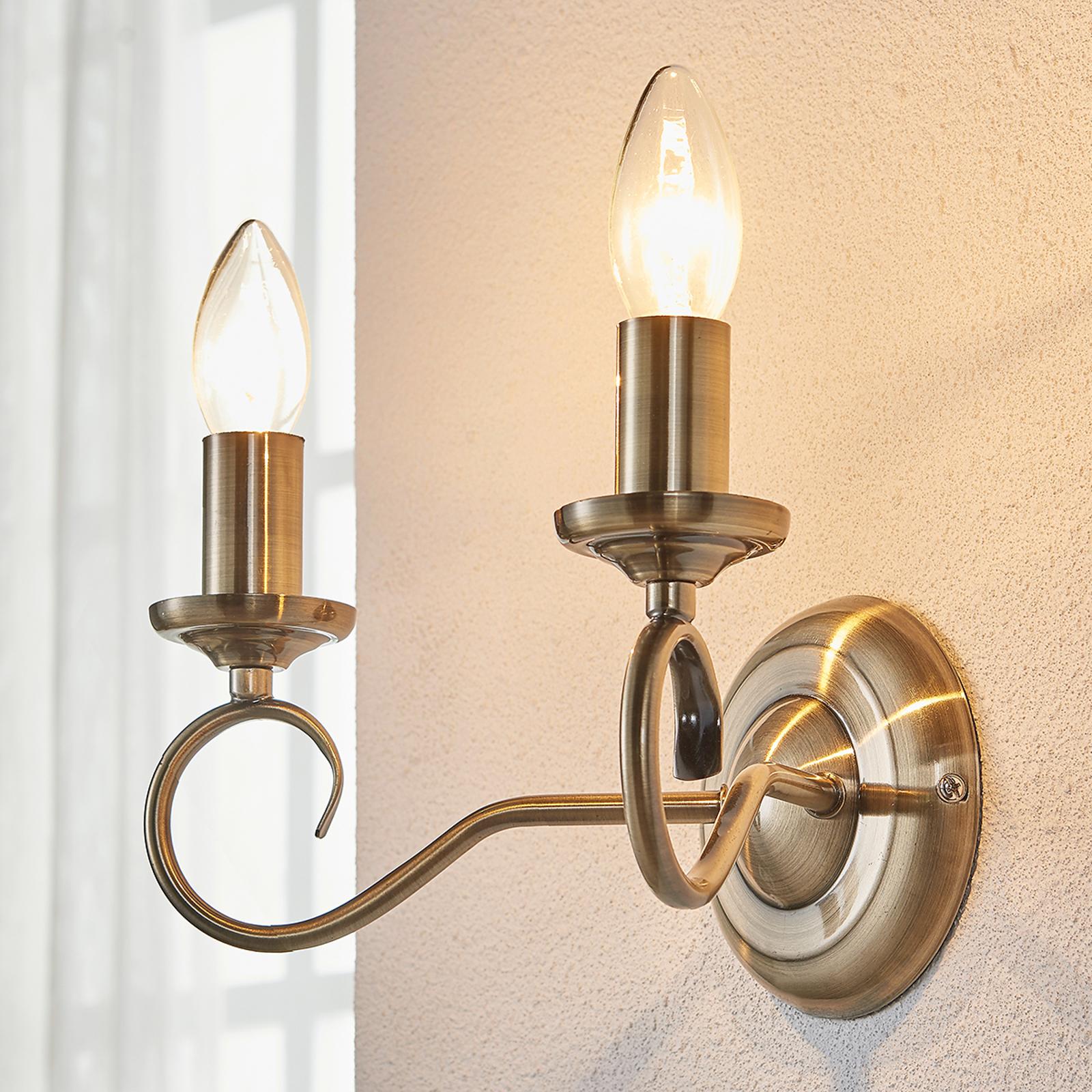 Elegante wandlamp Marnia in oud messing