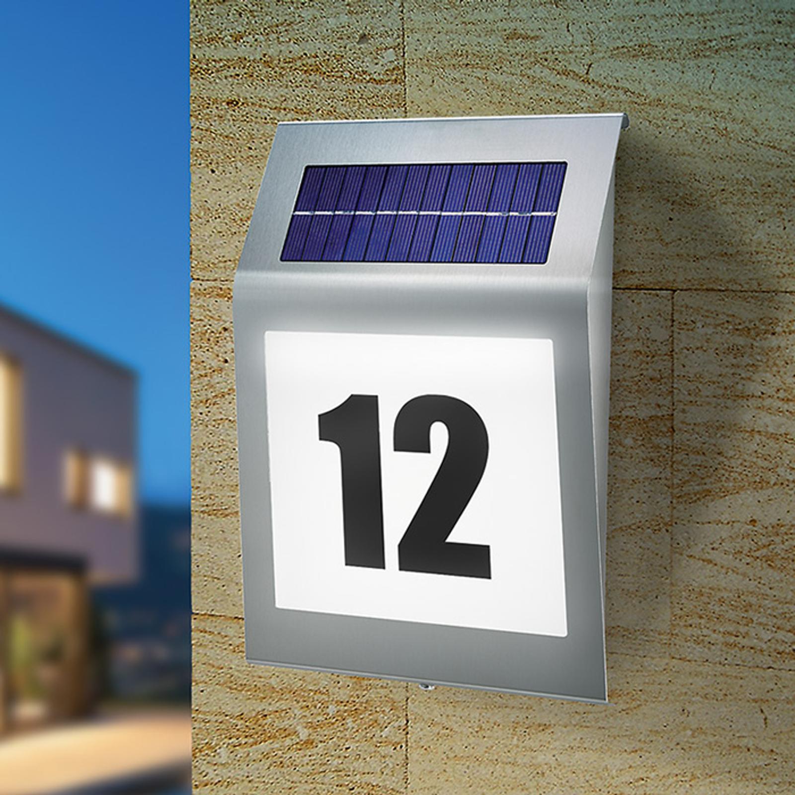 Numéro de maison lumineux solaire au design stylé.