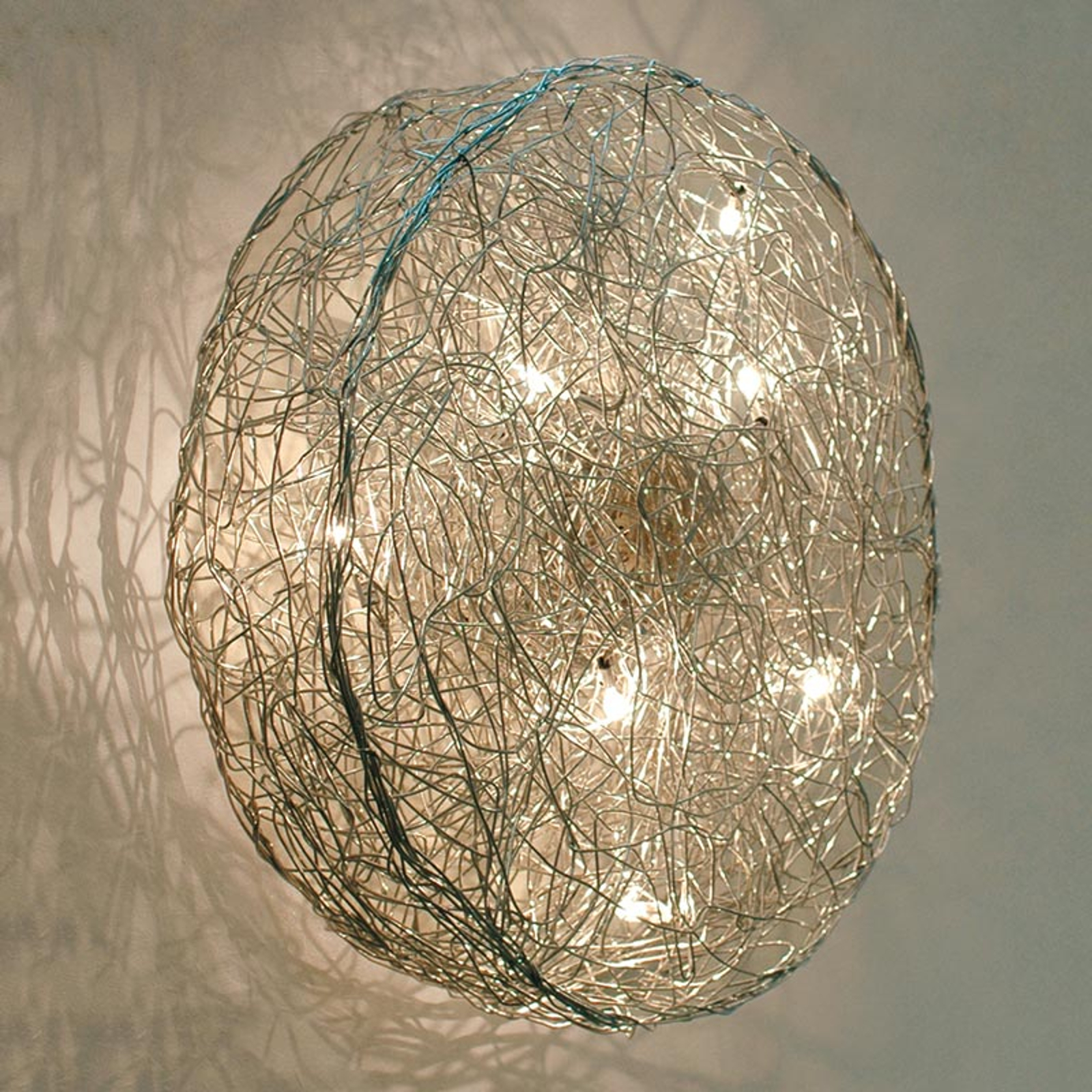Designerska lampa ścienna Rotola, średnica 100cm