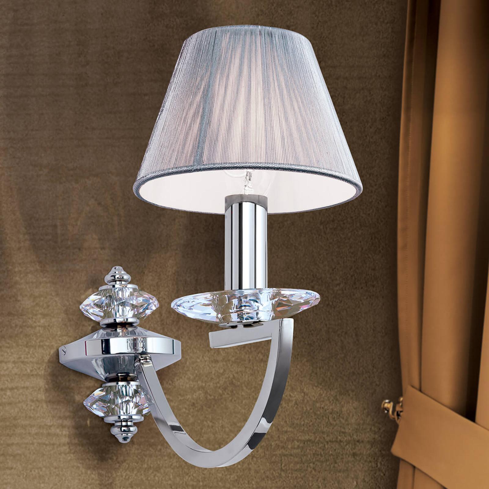 Wandlamp Avala met kristaltoepassingen
