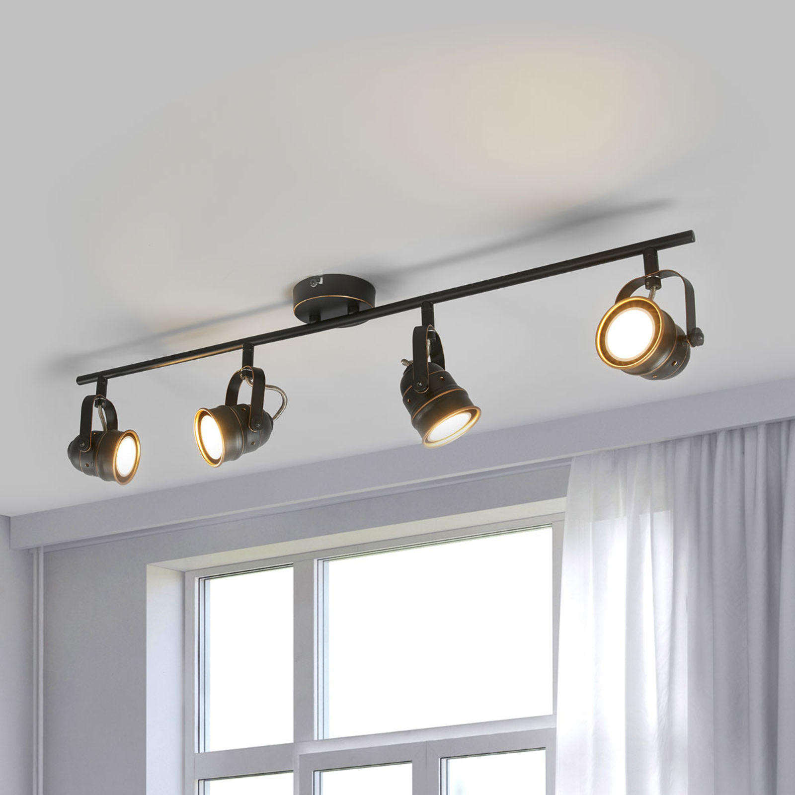 LED-vägglampa Leonor i svart-guld, fyra ljuskällor