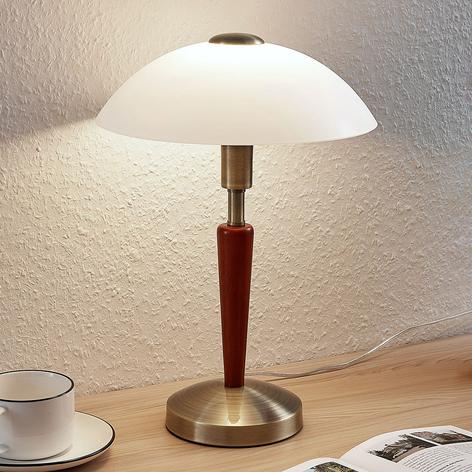 Bordlampe Tibby med en glasskjerm og tredekor