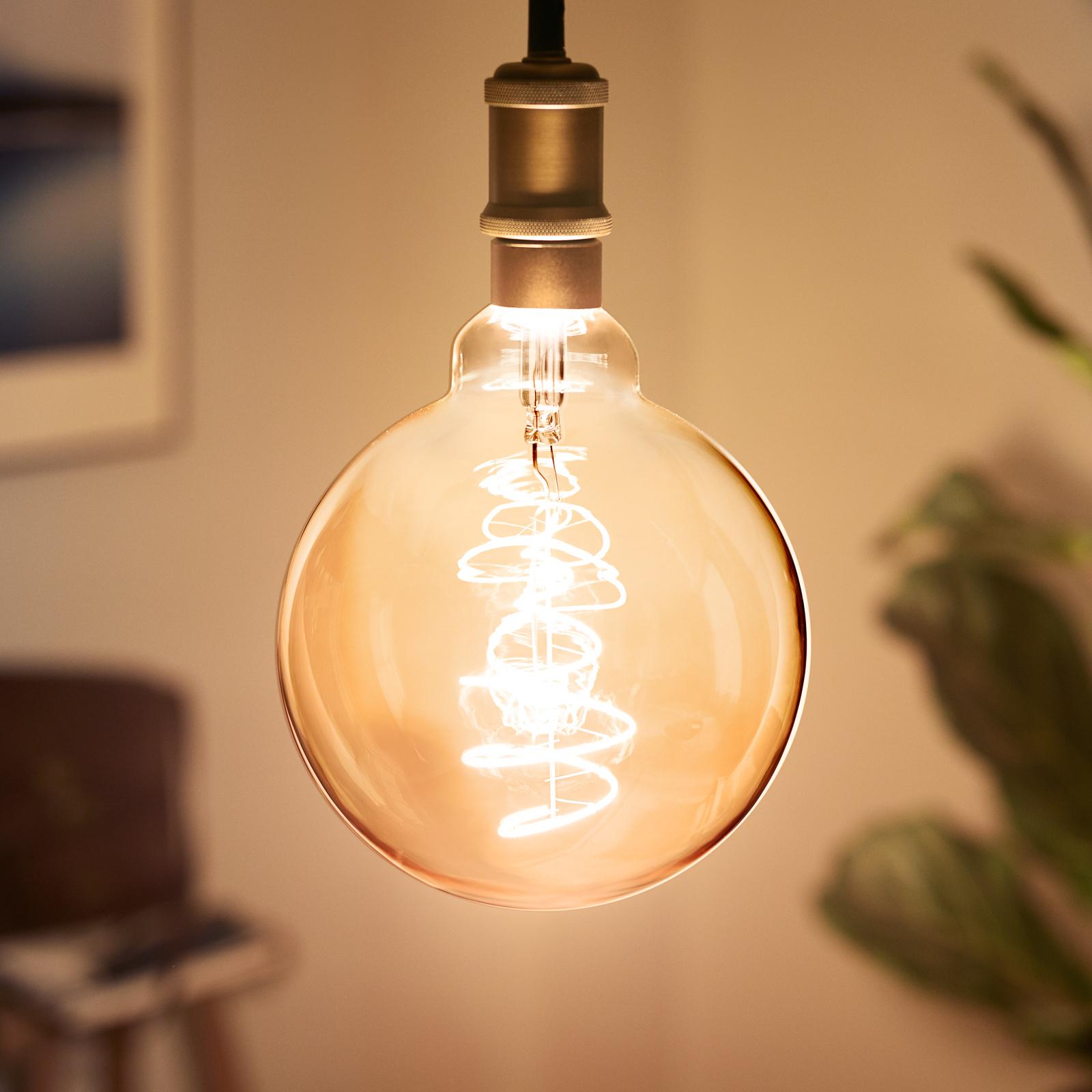 Philips LED-Globelampe E27 G95 5,5W 1.800K gold