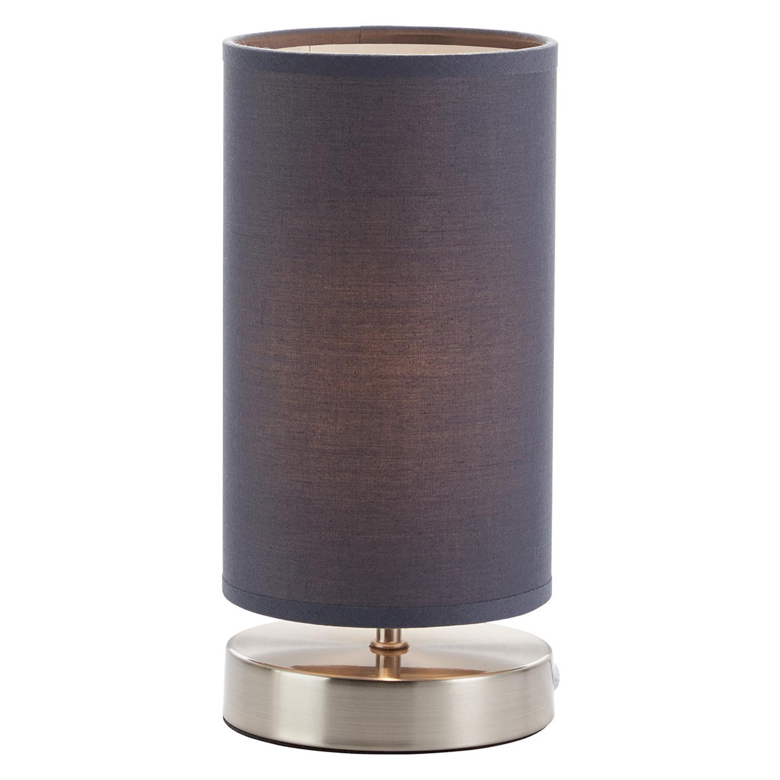 Stolní lampa Claire s šedým látkovým stínítkem.